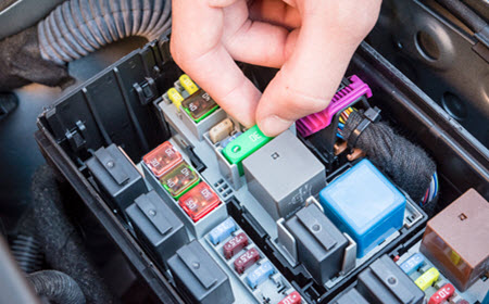 Mercedes Mechanic Checking A Fuse